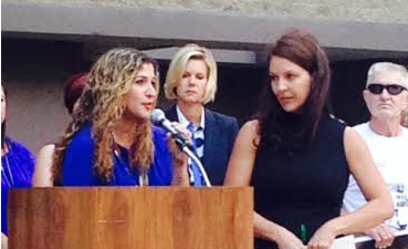 Jessica Yaffa speaking at a domestic violence event