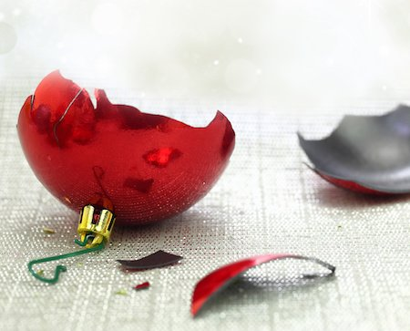 Broken Christmas ornament due to domestic violence during the holidays
